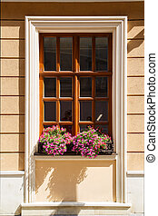 window with flowers - brown wooden window with pink flowers...