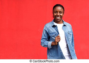 Smiling young woman against red background