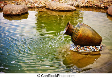 small fountain in metal jar