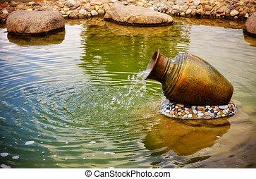 small fountain in metal jar