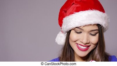 Sensuous young woman sucking on a candy cane - Sensuous...