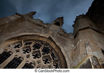 Halloween church - Dark clouds above an English 15th century...