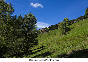 Refuge - Distant view of a shelter in Seiser Alm on a sunny...