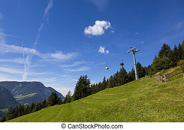 Cableway - Bottom view of a cableway in a sunny day in...