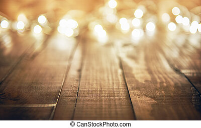 lights on wooden rustic background - Christmas garland...