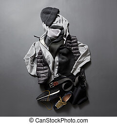 Beautiful men's clothes and accessories on a black...