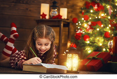 girl writes the letter to Santa - Merry Christmas and Happy...