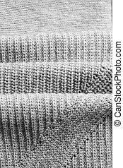 Knitwear texture background - Close up of folded wool...