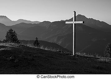Mountain landscape with a wooden cross