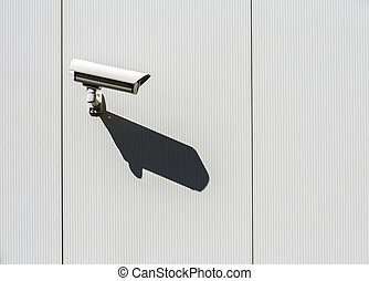 Security camera on a wall. - Security camera mounted on a...