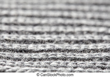 Gray ribbed knitted wool fabric cold weather background