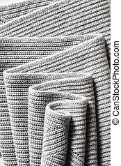 Draped melange gray woolen knitted fabric as background....