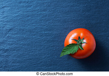 fresh tomato on blue background