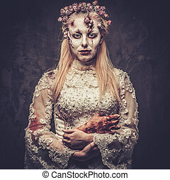 Dressed in wedding clothes romantic zombie woman. - Dressed...
