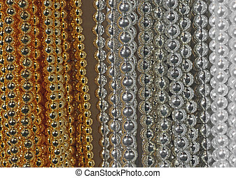background of precious necklaces of gold beads silver -...