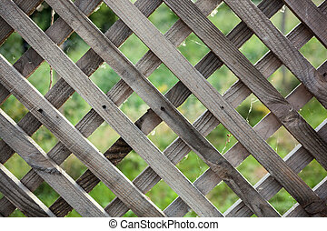 Old rough rhomb shaped fence. - Close up of an old rough...