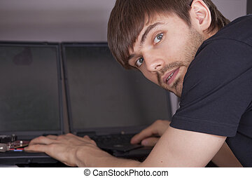 computer technician with laptops