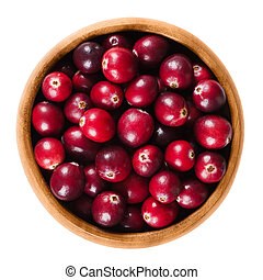 Fresh cranberries in wooden bowl over white - Fresh...