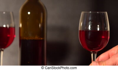 Red wine being swirled in wineglass