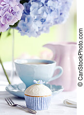 Afternoon tea served with a gourmet cupcake