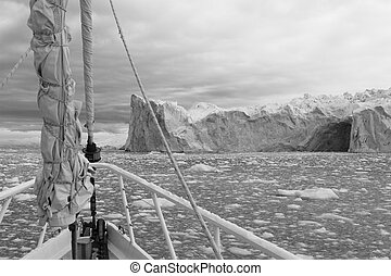 Sailing Antarctica - Sailing boat in Antarctic waters with...