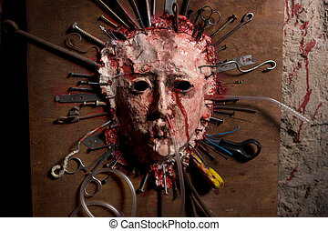 Close up of a skinned bloody face of a person stretched open...