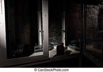Blood stained laboratory with glass case and tubes -...