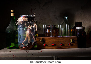 Horrible dead creature with bulging eyes inside jar sealed...