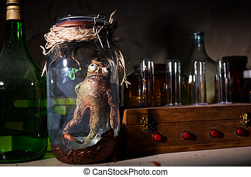 Dead creature inside mason jar - Dead creature with bulging...