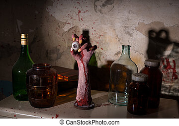 Wrinkled hand with eyeball between glass jars with blood...