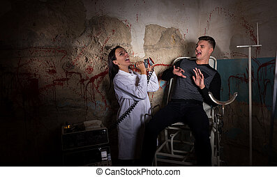 Demented scientist and patient in dungeon - Demented...