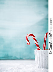 Candy cane on snow