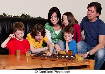 Family together in the livingroom - Big family is playing a...