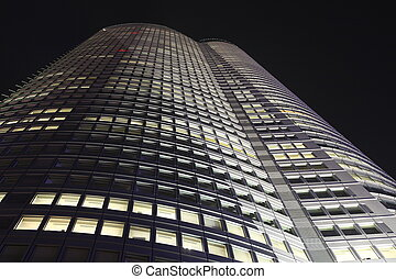 Small part of Facade of skyscrapper in Tokyo at night