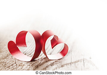 Ribbon hearts on wooden background - Two red small ribbon...