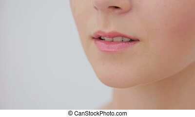 Close up of young woman's lips