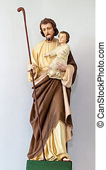 Sculpture of Saint Joseph with little Jesus Christ in church...