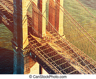 Brooklyn Bridge over the East River in New York City at...