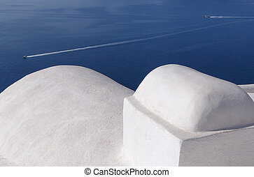 whitewashed Cycladic house in Oia - traditional whitewashed...