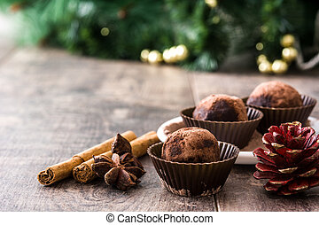 Christmas chocolate truffles on wooden table