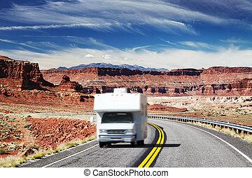 RV Camper on highway - Traveling by motorhome, American...
