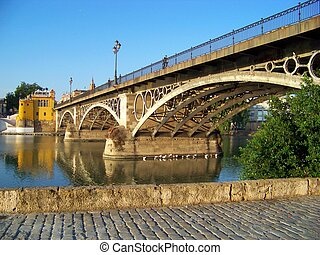 Triana Bridge in Sevilla - Triana Bridge spans over the...
