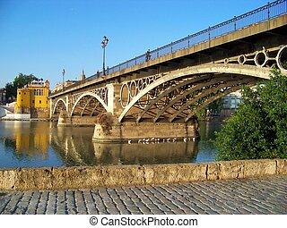 Triana Bridge in Sevilla - Triana Bridge spans over the...