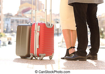 Travelers legs and suitcases in a travel location - Back...