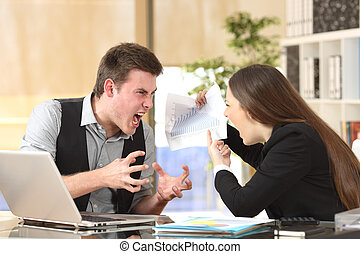 Two angry businesspeople arguing furious