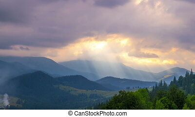 Sun Rays Pass through the Clouds - Time Lapse. Mountain...