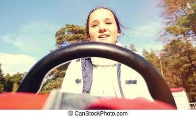 Young smiles beautiful woman driving ATV, hand hold steering...