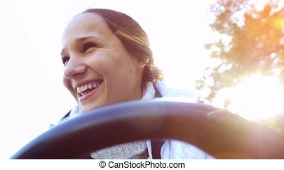 Young happy beautiful woman driving ATV, hand hold steering...