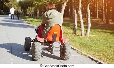 Young beautiful woman driving ATV in slowmotion. 1920x1080 -...