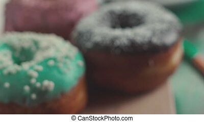 Colorful donuts icing on the air. Tea and donuts. -...